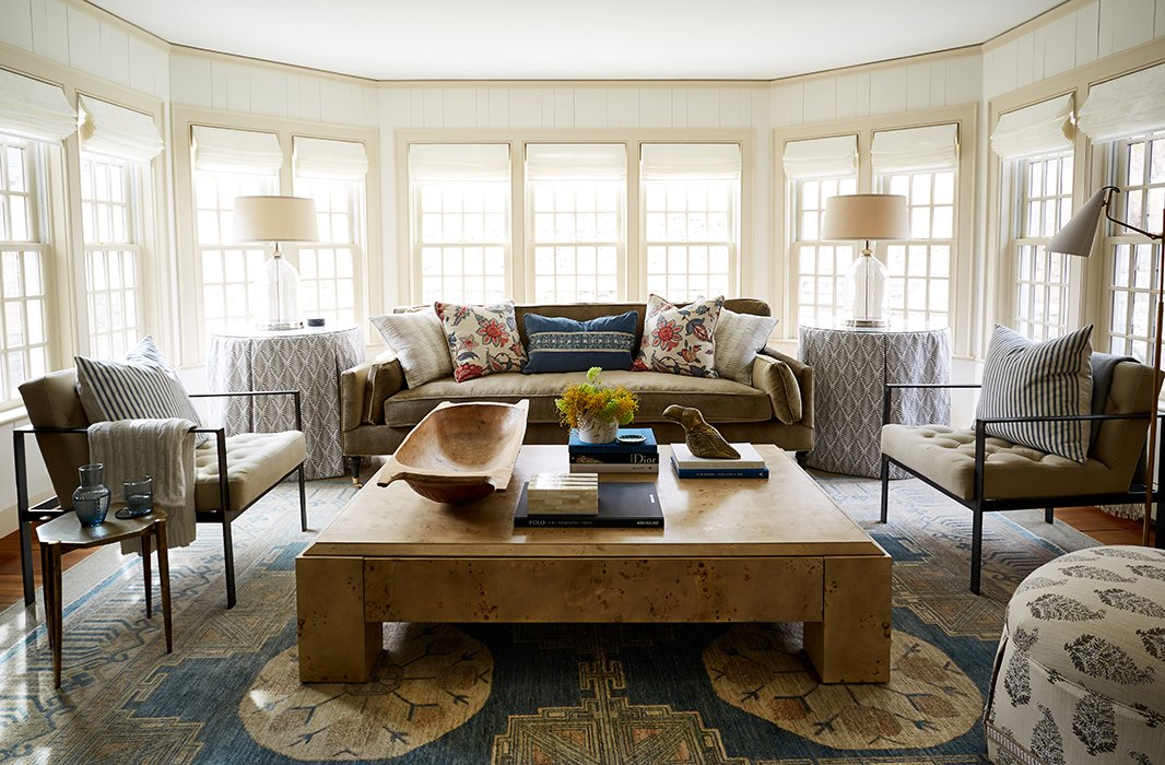 In the family room, a burl-wood coffee table by Kara Mann for Milling Road has disguised drawers that store toys; skirted tables flank a sumptuous brown velvet sofa that accommodates the whole family. A lover of prints, Debbie worked with Nicole to choose a range of textiles—from the pillows to the ottoman to the rug—that are lively yet easy on the eyes.