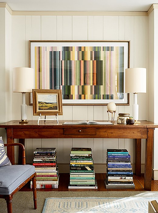 "Graphic art by David Grey, a favorite rising star at One Kings Lane, is one of the family room's most eye-catching contemporary features. It works because ""it goes with the color palette we established at the beginning of the project,"" says Nicole."