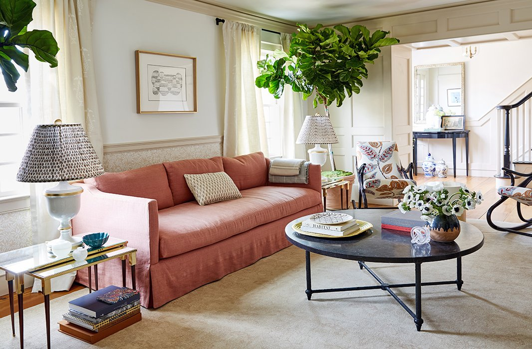 The living room's soft palette creates a space primed for relaxation.
