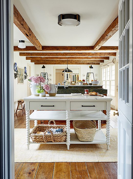 Spindle furniture legs, as seen on the console here, are particularly popular in farmhouse-style spaces. Photo by Frank Tribble.