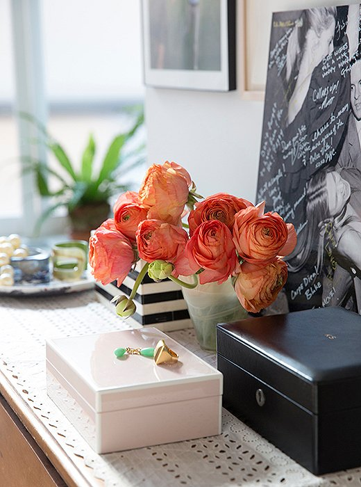 "A monogrammed leather jewelry box by T. Anthony sits atop a dresser in the master bedroom. The wall behind is dedicated to family photographs displayed in silver frames given as wedding gifts, ""that's our little family shrine area,"" she says."