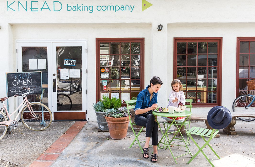 "Lawren and daughter dig into breakfast at Knead. ""We watched the Fourth of July parade from their patio."""