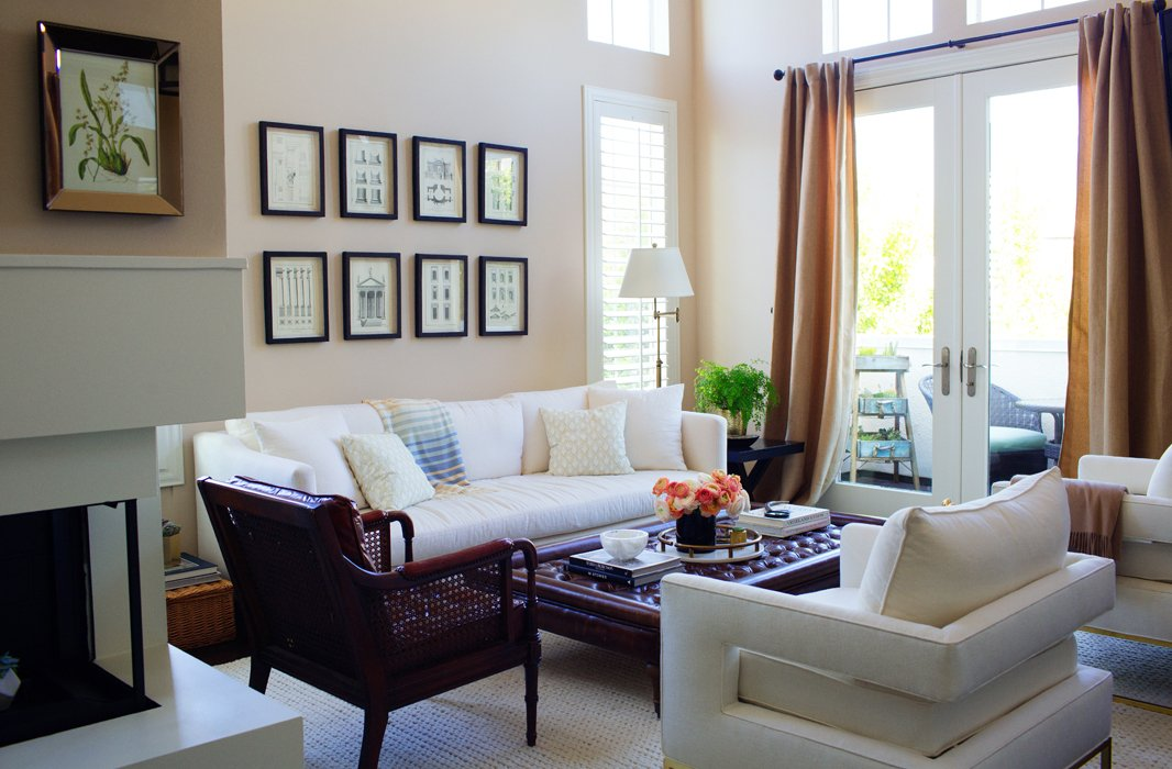 While Louise isn't one to shy away from bold colors and prints in her wardrobe, her home needed to be a comfy and calming counterpoint. Cue the furnishings in creams, dark woods, and rich leathers, which include white club chairs and a sofa found on One Kings Lane.