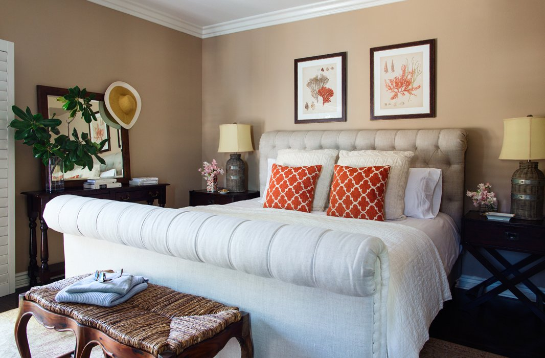 """I wanted a gigantic sleigh bed, and I think I got one,"" laughs Louise, who went with moody taupe walls in the master bedroom for a rich, soothing vibe along with playful notes of coral. ""I like to keep things neutral and then just add a little punch of color here and there."""