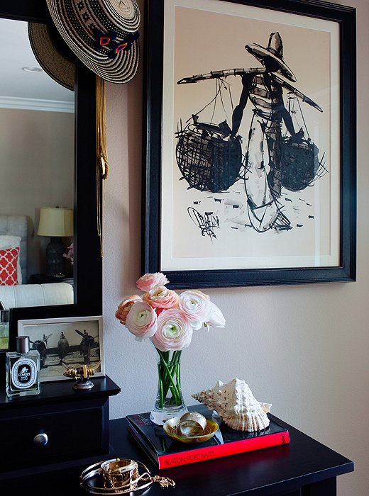 """Hanging above the dresser, where catchalls hold everyday and costume jewelry, is one of two sketchesthat belonged to Louise'sgrandmother. """"They'refrom Brazil and my granny owned them for 50, 60 years, and I brought them out from England and reframed them,"""" Louiseexplains."""