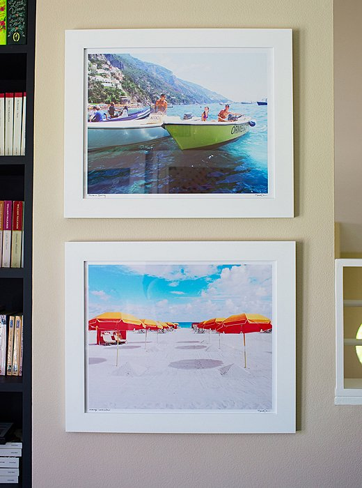 "Photographs by Natalie Obradovich depicting the Amalfi Coast (""Staring at those for a year has made me now book a trip there!"") punch up the office's cream walls and the bookshelves filled with Louise's enormous book collection from her college days. ""I studied English literature, so I'm a bit of a bookworm,"" she laughs."