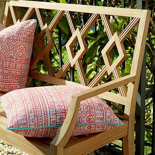 Marine-grade teak, shown here in a piece from our Aviva Collection, is - Our Essential Outdoor Furniture Care Guide