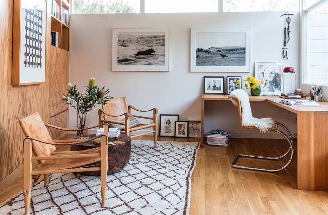 Inspired by the portable camp chairs used by English officers on safari, Kaare Klint's Safari Chair (1933)—shown here at left in the home of stylist Jessica de Ruiter—can be taken apart and reassembled without the use of tools. Photo by Nicole LaMotte.