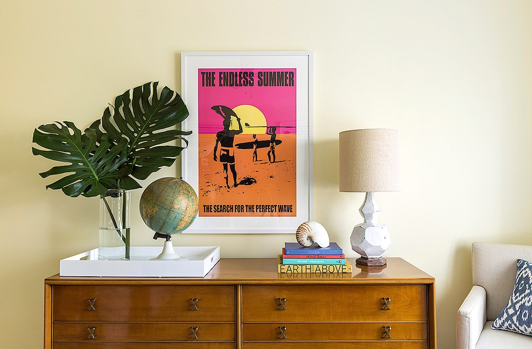 A colorful movie-poster print of one of Matthew's favorite surf documentaries, The Endless Summer, hangs above a vintage Paul Frankl dresser in the guest bedroom.