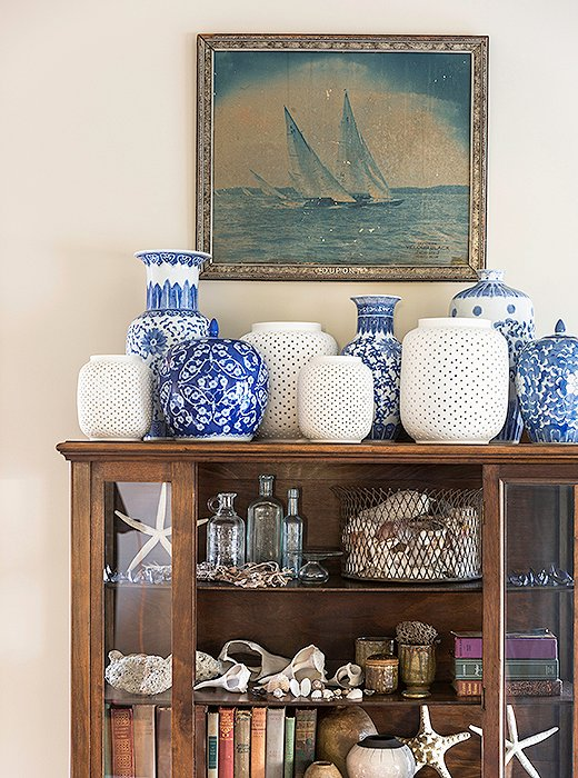 A china hutch that belonged to one of Matthew's grandmothers has pride of place in the living room and is filled with blue-and-white porcelain from his other grandmother, antique books, and shells he and his husband have amassed over the years.