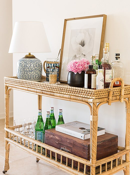 The bar is always self-serve, says Matthew, who fancies sidecars and, in summer, mojitos. The bar cart is enlivened with a repurposed vintage ginger-jar lamp and a print by Ron van Dongen.