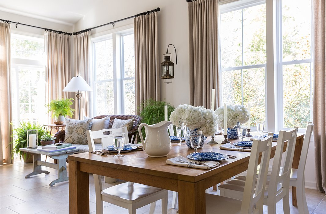 """The challenge of one large room is how do you make it work all together but also have separate intimate spaces,"" says Matthew of the inviting, casual dining and lounge areas facing the family room. The setup is perfectly suited to his laissez-faire approach to the home and entertaining—informal family-style meals and seafood feasts that are ""casual, comfortable, nothing fussy at all."""