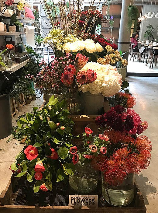 Seasonal blooms are arranged on-site for sale and display at La Ménagère.