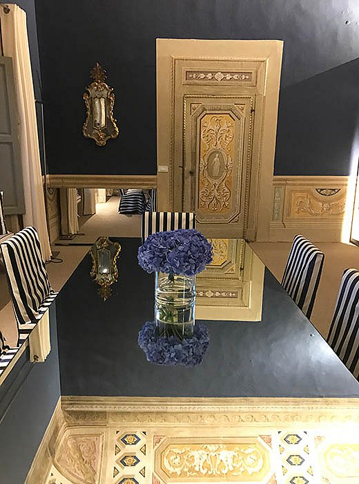 With mirrored tables and plenty of trompe l'oeil, the offices of the Italian shoe company Aquazzura are yet another source of lavish inspiration for Indré.