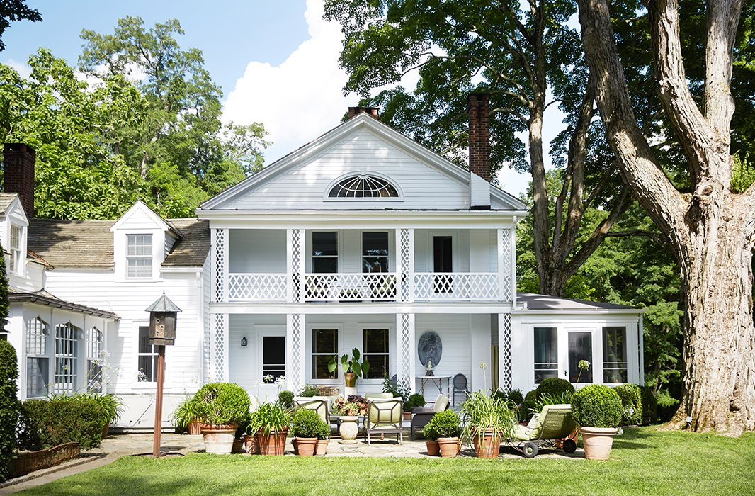 """Bunny and John's bedroomon the second floor overlooks the stone terrace and loggia. """"One of my favorite views of the house is from the porch right off our bedroom,"""" Bunny writes."""