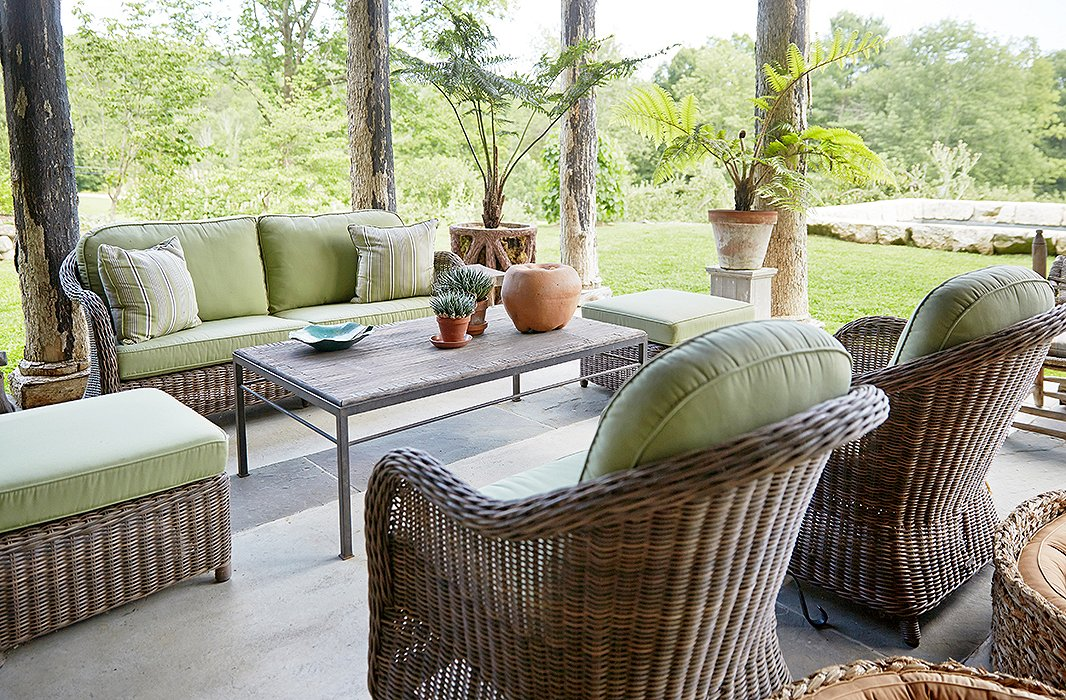 So as not to distract from the idyllic natural surroundings, Bunny maintained an organic feeling with unglazed pots, a bamboo coffee table, and pale-green-cushioned wicker lounge seating by the Belgium maker Vandecasteele Marc & Co.