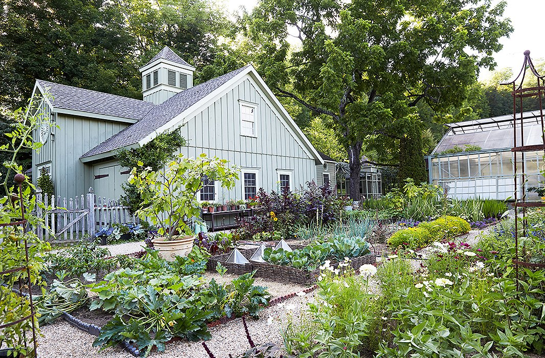"A board-and-batten barn, taking after 19th-century carriage houses, overlooks the vegetable and cutting gardens where ""no two summers are quite alike"" and snapdragons and zinnias, rosemary and thyme, and loads of dahlias overflow each year."
