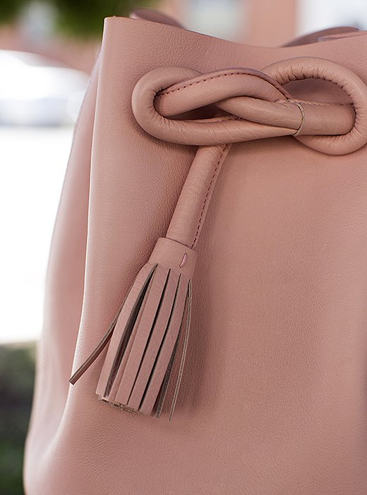 Details like the tasseled slipknot on the suede-lined Dana bag make for a chic finishing touch.