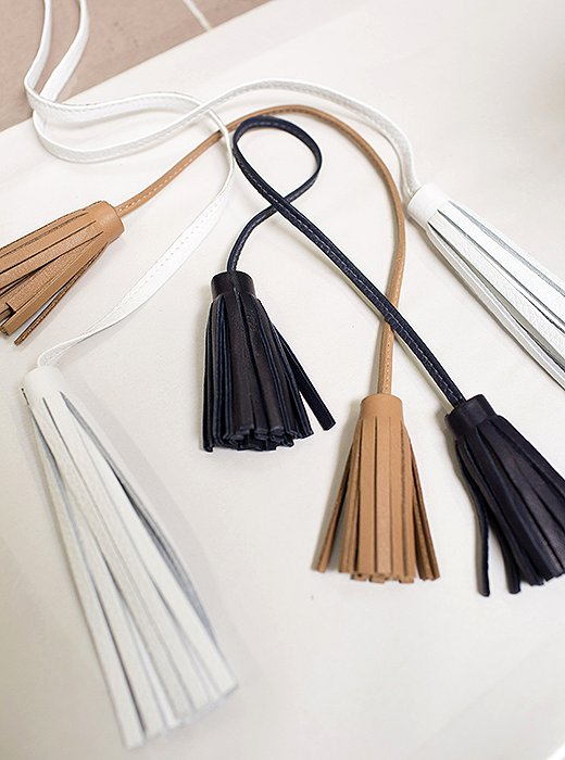 Every tassel is made by hand, from the stitching to the hand-painted top.