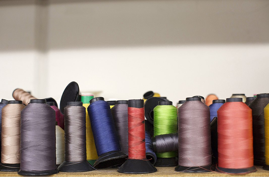 Spools of colorful threads are at the ready and provide a snapshot of the vibrant hues that are a hallmark of Shaffer LA.