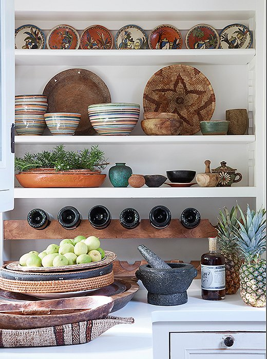 One of the easiest ways to incorporate this trend into your home is through a collection of curated accents. Here, Kendall Conrad turned open shelves into an Insta-worthy display, stacking larger vessels below and leaning a pair behind dishes up top.