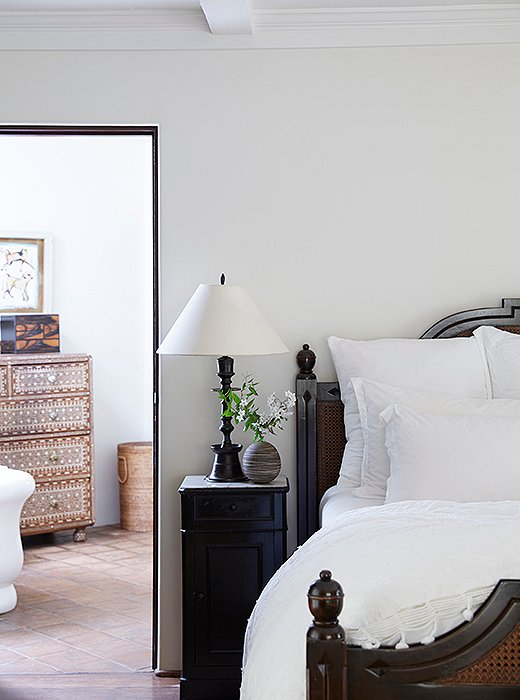 "The master suite is a serene, breezy retreat. The centerpiece is a striking wood-and-wicker bed and set of nightstands ""They're custom by Brenda Antin and a future heirloom for our daughters,"" Kendall says. Nightstand essentials? ""Books, lip balm, and hand cream."" The bedding is Matteo."