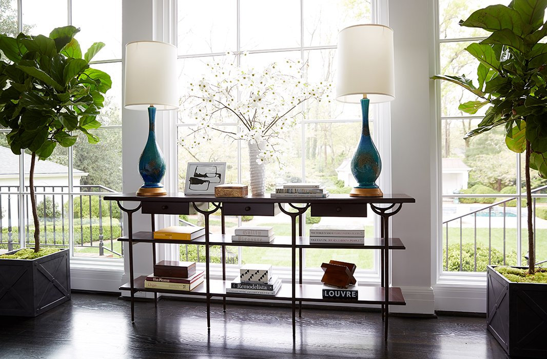 The open lines of this credenza allow plenty of natural light to flow in while giving space for coffee table books and favorite objets.