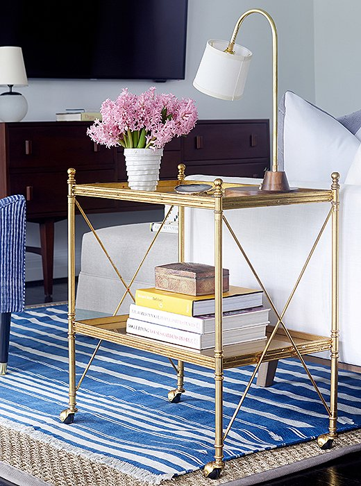 A blue-and-white striped rug equals instant coastal ease. Gold or brass touches elevate the look. Photo by Manuel Rodriguez.
