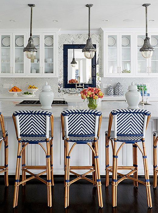 In the newly decorated kitchen, the only pieces that remained from the original design are the trio of antiqued steel pendants, which Cassie picked up on a drive through Franklin, TN.