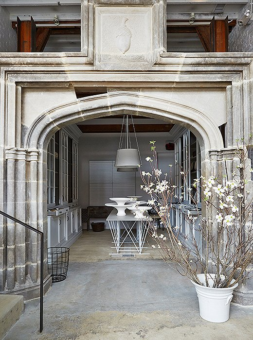 In the shop's entry, poured concrete floors pave the way to a grand greeting: a limestone arch salvaged from a manor house on the Potomac River.