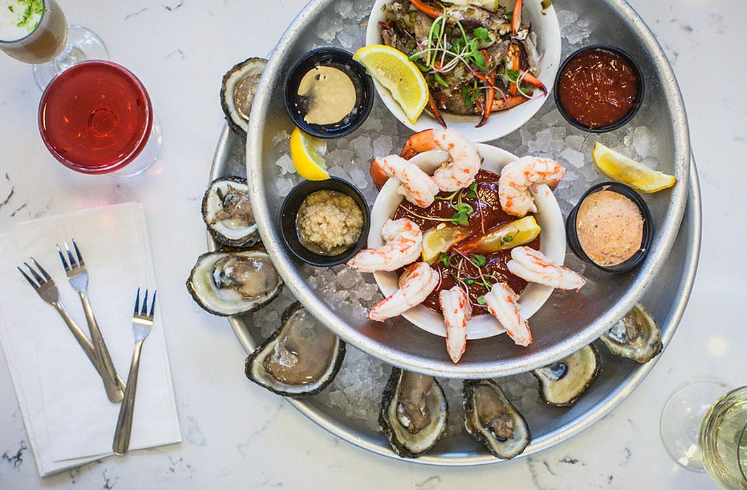 A delicious seafood spread at St. Roch Market, a light-filled Southern food hall inside a restored 1875 market building.Photo byGabreille Milone.