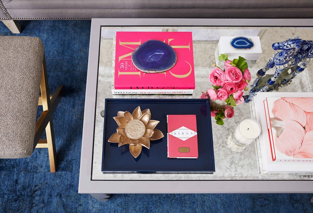 Natalie loved her neutral wall hues and wanted to keep them. We decided to take color to the floor, adding a burst of bright blue to the space with a rich overdyed rug.