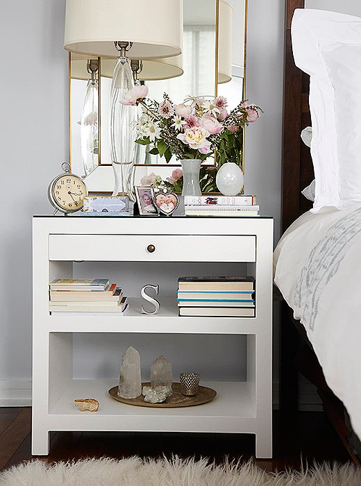 "The nightstand is all about personal effects: inspirational books, family photos, a collection of crystals—""anything that has meaning, that's important to have in your bedroom,"" Sarah says."