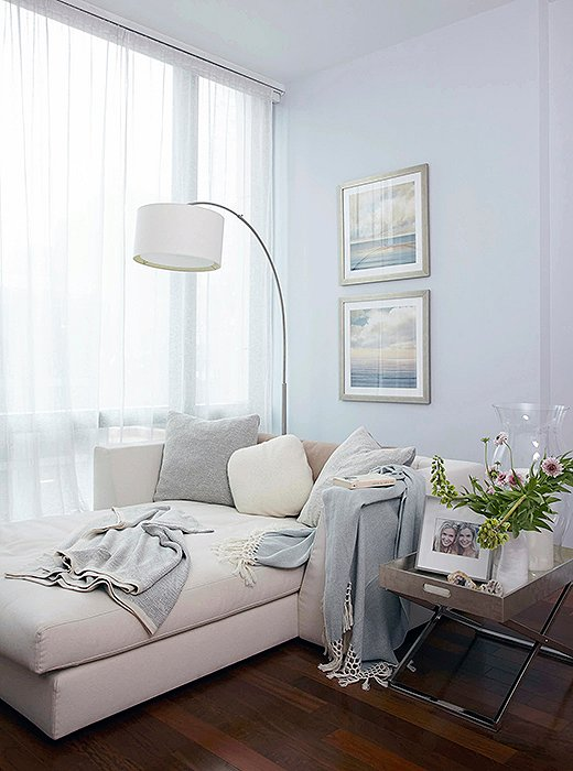 """The comfortable chaise gets a lot of action in Sarah's bedroom, from her morning and evening meditations (with a Sefte meditation cushion and shawl, of course) to nighttime reads with her boys. """"There are a lot of special, connecting moments that happen there,"""" she says."""