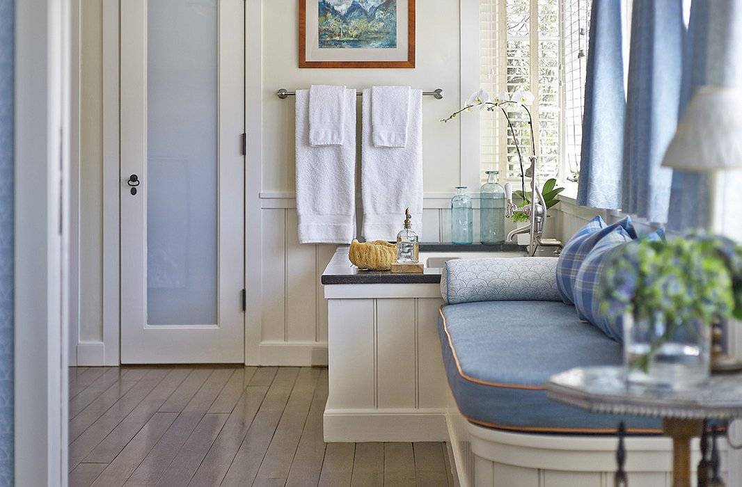 The bathroom at Hillside beckons with a dreamy blue palette and an even dreamier tub.