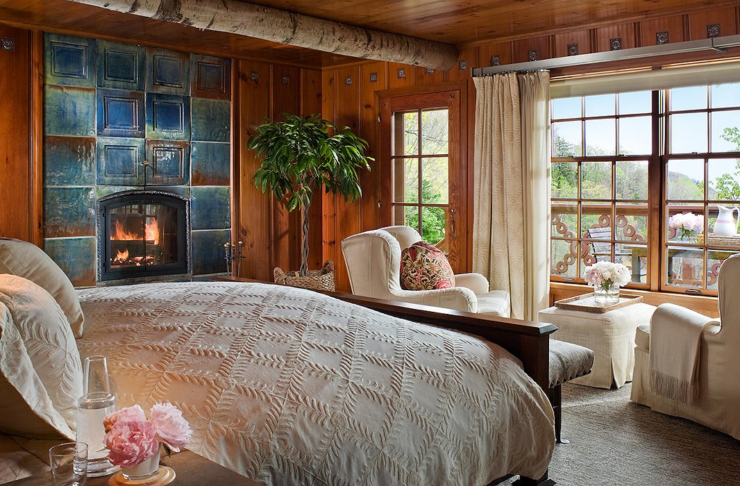 """Tons of natural wood—butternut, oak, maple, pine—flow throughout all the spaces,"" Michael notes, including the cozy bedroom of the Chalet."