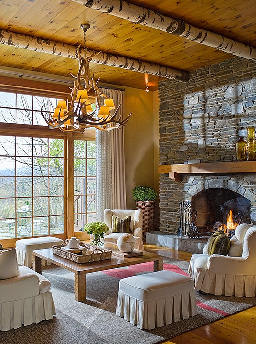 Soaring ceilings and a stone fireplace set the scene for post-hike relaxation in the Chalet.