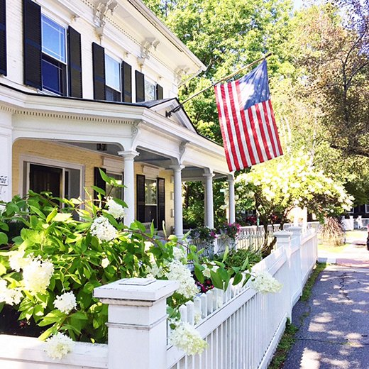 White picket fence, American flag—it doesn't get more classic than this handsome Woodstock home.