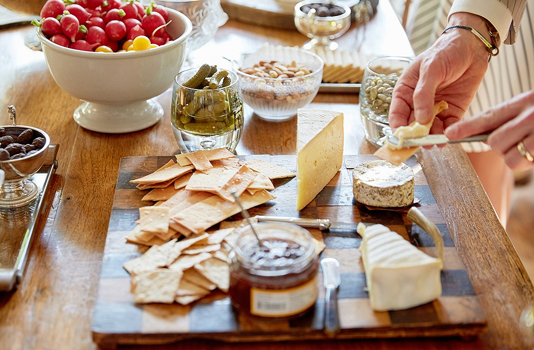A simple cheese spread on a checkered wood board makes for a character-filled display.