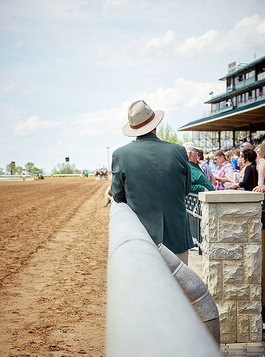 A man surveys the crowd just before the first race.