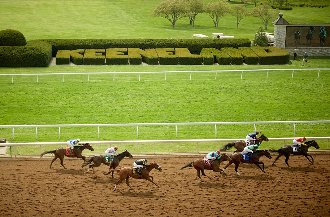 Horses run the track at Keeneland.