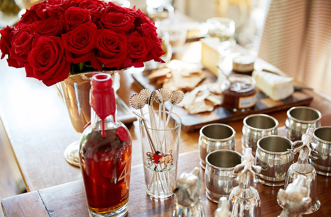 Silver straws and vintage glassware, at the ready for one of Jon's famous takes on the old-fashioned, also elevate the party scene.