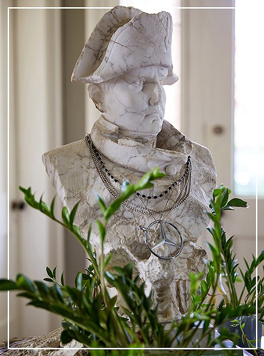 Aristocratic funk: A bust of Napoleon greets visitors atop a pedestal table in the foyer of Jon's home.