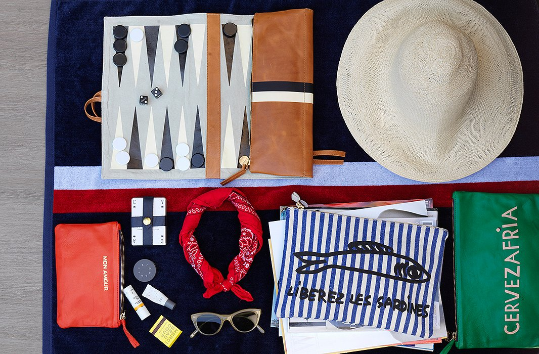 "Clare brought her own entertainment for our day at the pool: a leather backgammon roll, a deck of cards in a leather case, and a stack of the latest glossies. ""They're essentials for a great day at the pool or a day at the beach, which is the best type of day for summer,"" she says."