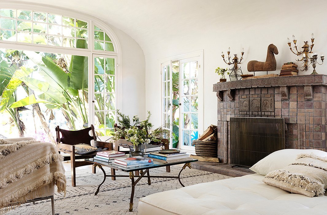 """When I finish a collection, my eye turns to my house,"" says Heidi. ""The inspiration doesn't stop at work."" In the living room, texture and form converge to create an idyllic California hangout. The daybed is from a now-shuttered neighborhood shop, and the Moroccan rug was found on One Kings Lane."