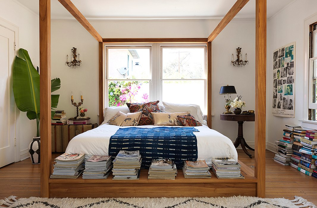 "Heidi's favorite spot in her home? Her bed—an amazing piece designed by Bernard Brucha of MASHstudios. ""Isn't it awesome?"" says Heidi. ""I got it for my 40th birthday—best present ever."" A Moroccan rug, Heidi's own pillow designs, and an indigo throw blend to create a down-to-earth vibe. ""I like things to be a little undone."""