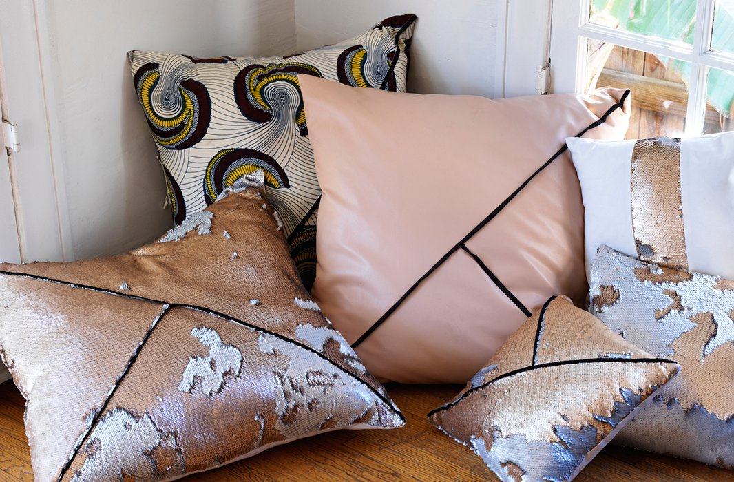Heidi's signature collection of pillows, cut from the same fabrics as her dresses and skirts, run the gamut from brilliantikats tonude leathers tosequins.