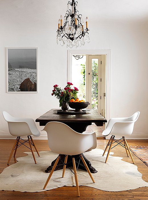"""The design cred of Eames chairs is great, but so is theirpracticality. """"When you have kids, these are the best chairs,"""" Heidi says. The antique table was a gift from her mother-in-law when she was first married. """"She's awesome. There's wisdom in buying a young girl a beautiful piece of furniture."""" The hide is from Argentina."""