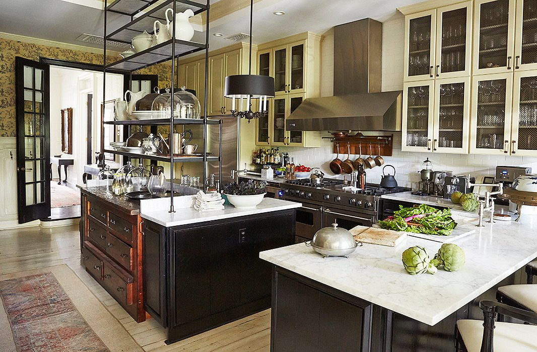 "With an impeccably designed kitchen—reclaimed hardwood, black lacquered cabinets, Carrara marble counters, an iron étagère atop the island, a state-of-the-art range—you might expect Darryl to be a master chef. Au contraire. ""I do not cook. At all. Anything,"" he says with a laugh. ""I will occasionally do the dishes."""
