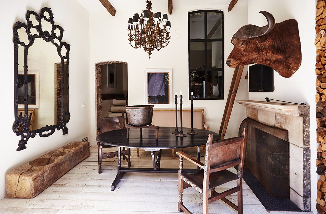In the lower family room, an antique African water-buffalo head and a 19th-century ladder bought at a Paris flea market are conversation starters. Most of the floors in the home—including these—are the original oak.